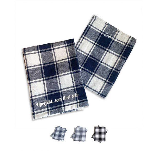 """To kjøkkenhåndkle med trykket """"Uperfekt, som livet selv"""" og Krem.no-logo, tilgjengelig i 3 forskjellige farger"""
